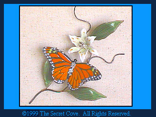 Monarch Butterfly with Lily. B80 Metal wall sculpture by Bovano.